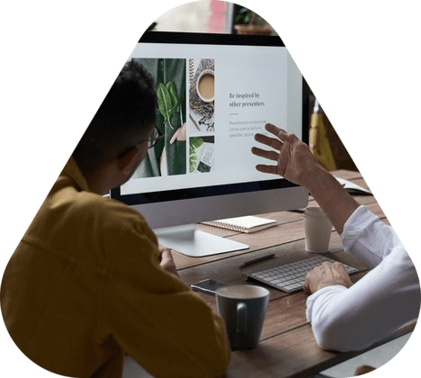 Man discusses web design project with client in office