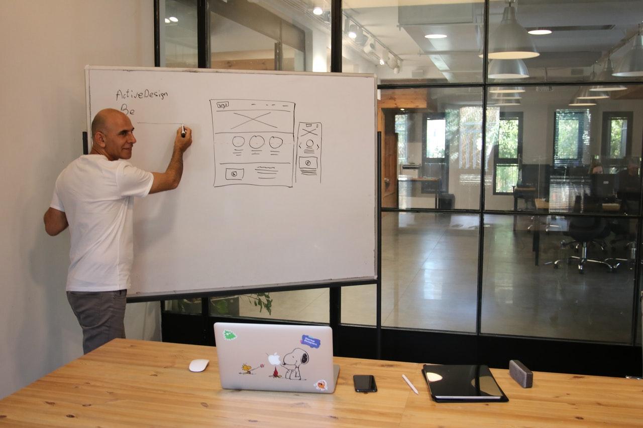 businessman explaining conversion focused web design